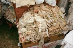 suitcase filled with vintage lace