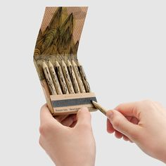 MoMA pencils from recycled paper packaged in a matchbook-style box with built-on sharpener. Very cool.