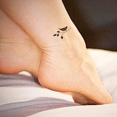 29 Super Cool Bird Tattoo Designs, Ideas & Placements