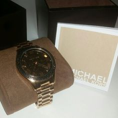 Mk rose gold watch with black crystal face Rose gold  Black crystals Work's fine No damages No scratches on face No discoloration Box booklet and links included The links were already added on to make bigger Michael Kors Accessories Watches