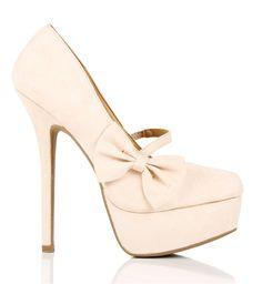 Cream platform heels with bow.