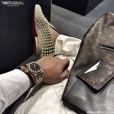 Northskull Essentials !   @Officialthura is ready to go with these luxury essentials   Christian Louboutin Dandy Spike Shoes, Louis Vuitton Neo Porte Card Holder, Louis Vuitton Palk Backpack & his Audemars Piguet Royal Oak Watch nicely paired with our premium Navy Nappa Leather & 18kt. Rose Gold Twin Skull Bracelet. Nice combo !   Available now at Northskull.com   What's on your essentials list ? Post a photo of your essentials with the tag #Northskullessentials on Instagram