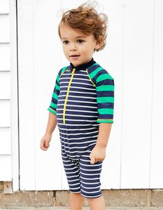 Remember baby's first trip to the beach for all the right reasons with our fun surf suit. We love the comfortable material and contrasting stripes. A zip down the front makes changes so easy you could do them one-handed (leaving the other one free for a well-deserved ice cream, of course).