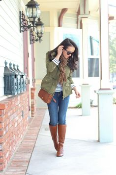 Jeans, tan riding boots, green military jacket, striped shirt and animal print scarf. Such an easy and classic look!