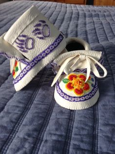 Baby bear moccasin with raised floral beadwork by Sadie Thompson