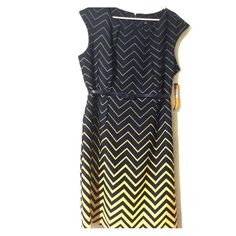 Perfect for a summer wedding This little beauty would be perfect to wear to a summer wedding or kids graduation or even just on a girls day out. Sleeveless dress with a yellow and dark blue chevron print. There is a belt for around the waist. Dresses