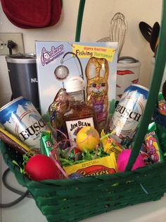 A mans Easter basket, Busch beer, Jim bean, a fishing bunny, Reese's eggs, Cadbury eggs, and confetti eggs