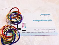 Dangle earrings a rainbow of colored by EarringsBraceletsEtc
