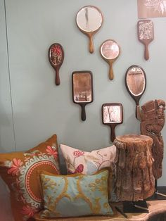 Hand mirrors on the wall - lovely!