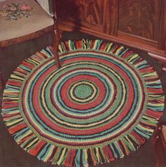 -Round-Rug..great way to use up your scraps of yarn left over from projects.