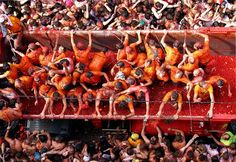 La Tomatina festival in Valencia, Spain hosts 30,000 people in the largest tomato fight around the end of August each year.