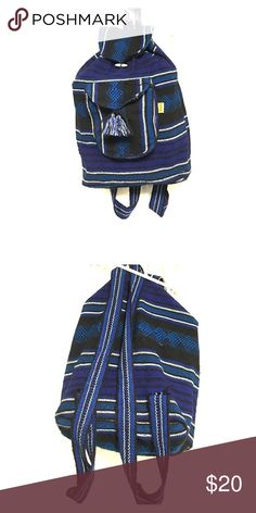 Mexican backpack Super cute blue, black, and white Mexican backpack.  Lightly used and had a front pocket with a zipper and tie with tassels. 5f3559544a