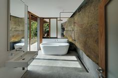 MY FUCKING DREAM BATHROOM> SO RAD. <3  The cliff face actually comes into this bathroom in Cliff Face House by Fergus Scott Architects with Peter Stutchbury Architecture, from the Houses Awards.