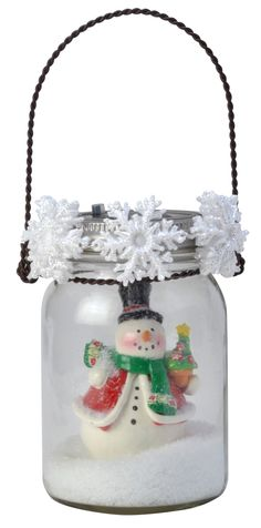 Turn your jar into a magical snowglobe using an ornament, garland and fake snow.
