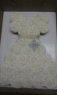 27 cupcakes create this wedding dress shower cake.