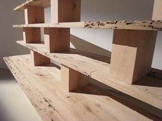 a shelving system made from recycled docking posts inherent to the venetian landscape