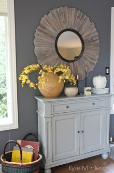 Benjamin Moore Gray, the best paint colour. Country style home decor on a gray painted buffet in dining room with yellow and gold accents and rustic mirror