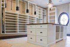 ironing board in closet, island of drawers in closet Just think of all the organization possibilities in this space from Big Closets, Dream Closets, Closet Island, Closet Drawers, Laundry Room Cabinets, Closet Remodel, Master Bedroom Closet, Luxury Closet, Clothing Organization