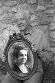 Henri Cartier-Bresson with a portrait of his mother, Marthe Leveneier.