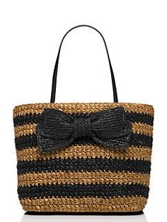 our rollins street laure--an open-topped tote made from basket-woven straw and finished with an oversized straw bow--looks equally fantastic with jeans, sundresses and bikinis.