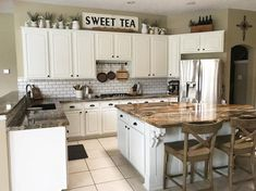 These are 10 inventive ways to decorative the space above your kitchen cabinets. kitchen decor above cabinets 10 New Ideas for Decorating Above Your Kitchen Cabinets Top Of Cabinets, Above Cabinets, Open Cabinets, Dark Cabinets, Decorating Above Kitchen Cabinets, New Kitchen Cabinets, Rustic Cabinets, Decorating Ideas For Kitchen, Cabinet Top Decorating