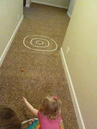 """Masking tape indoor games -hopscotch, bulls-eye bowling, tic-tac-toe, guard the eggs, long jump, ......balance beam""""............good for rainy days or cold weather!"""