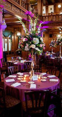 Tall purple floral centerpiece - weddingday-online.com