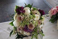 An English Vintage wedding bouquet in soft lavender hues, including Metalina Roses, Sweet Peas, White Peonies, fragrant Lilac and sweet scented Jasmine framed by fresh variegated Hosta