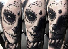 Dark realistic tattoo by Zsofia Belteczky.