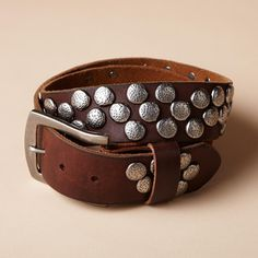 PEBBLE PATH BELT--Subtly distressed silvery studs create a pebbled path on a supple brown leather belt that wears with ease and lights up your look. Imported. Sizes S (32), M (34), L (36). Approx. 1-2/3W.