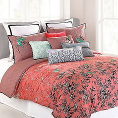 Liven up your bedroom with the bright and bold Nanette Lepore Botanical Porcelain Reversible Comforter Set. The vibrant bedding features a white and black botanical porcelain floral print, dark coral ground and perched songbird accents.