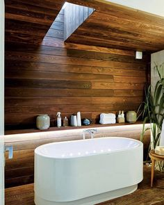 A Therapeutic Environment Featuring A Unique Tub Design And Skylight. By  Roomporn
