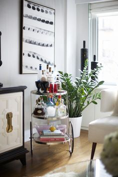 Round cart bar 35 Chic Home Bar Designs You Need to See to Believe