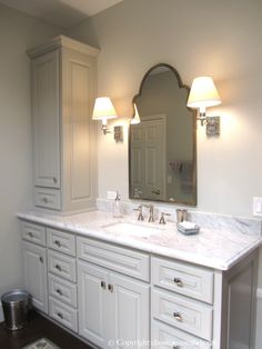 Master bathroom- Wisteria mirror, cabinets painted in Benjamin Moore Fieldstone,  Carrara marble counter