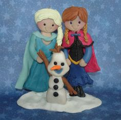Polymer Clay handcrafted Milestone Cake Topper. Anna and Elsa are standing in the snow with Olaf the Snowman.  Perfect for that special