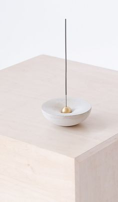 Curved cast concrete form that can be used as a taper candle holder or incense burner. Brass incense burner is removable. Made in the USA Concrete form is x x Incense burner is