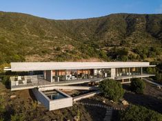Felipe Assadi Arquitectos completes elongated house with protruding volu...