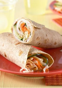 Tuscan Turkey Wrap -- Fresh veggies with Italian dressing and cheeses give this fabulous turkey wrap recipe its Tuscan-inspired deliciousness.