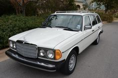 """this isn't my actual car but same year etc. 1985 Mercedes-Benz TD white. Mine has a """"tan"""" interior which is that beautiful '80s mustard tone.  Mine has some rust on the bottom of the doors. and some other places as well as some unknown ailment which keeps me from being able to drive it"""