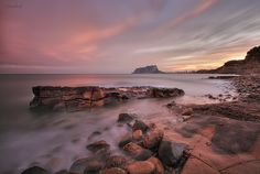 Moraira, image coast near beach Andragó, on the horizon the ifach rock Calpe.