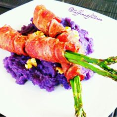 Peppered Turkey Bacon Wrapped Asparagus with Purple Yam Cinnamon Mash! I love the salty and sweet combination! Peel and cut purple yams (Okinawan yams). Put in pan of water until water boils and potatoes are tender. Mash in big bowl and mix in ground cinnamon. Wrap turkey bacon around asparagus and bake in 375 degree oven for 15 min. Sprinkle raw or toasted walnuts and serve! Eat Clean, Train Mean & Supplement in Between!