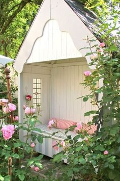 This outdoor reading nook -- complete with gorgeous pink roses -- makes for a dreamy backyard or garden addition.