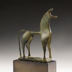 A Greek Bronze Figure of a Horse, Geometric Period, circa 8th century B.C. photo Sotheby's  of Corinthian type, of stylized attenuated form standing on an openwork rectangular base, with crested mane, long forward-pointing ears, and cylindrical muzzle; height 5 3/4 in. 14.6 cm. Estimate 150,000—250,000 USD. Lot Sold 842,500 USD
