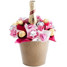 Pink Sparkling Chocolate Bloom - Luxurious and feminine, our Pink Sparkling Chocolate Bouquet features a piccolo of Henkell sparkling wine amidst 18 quality chocolates. A fun gift combination that is a little bit naughty but oh-so nice! Chocolate Flowers, Chocolate Bouquet, Birthday Candy, Birthday Gifts, Birthday Ideas, Graduation Bouquet, Unique Anniversary Gifts, Congratulations Gift, Valentines Presents