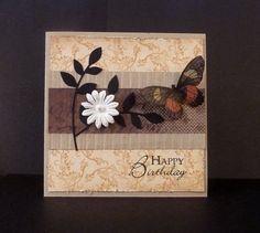 By Reddyisco at Splitcoaststampers. Branch is die cut from Memory Box. Butterfly cut from designer paper. Edges of background designer paper distressed.