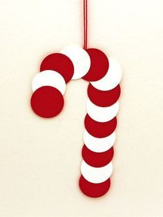 Simple materials and simple tools makes this paper circles candy cane ornament a fun, easy and quick project for anyone to do. Simple materials and simple tools makes this paper circles candy cane ornament a fun, easy and quick project for anyone to do. Christmas Crafts For Kids To Make, Felt Christmas Decorations, Christmas Paper Crafts, Preschool Christmas, Kids Christmas, Holiday Crafts, Christmas Candy, Spring Crafts, Candy Cane Decorations