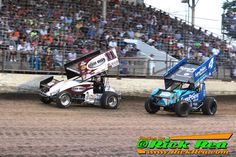 """World of Outlaw Sprint Car Driver #4 Cody Darrah from Re Lion PA passing #11 Steve """"The King"""" Kinser from Bloomington IN for the lead at The World Famous Legendary Bullring River Cities Speedway in Grand Forks ND - Photos by Rick Rea www.RickRea.com"""