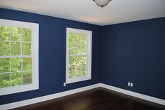 Benjamin Moore's Newburyport Blue (HC-155). How amazing is this blue? Especially with the white trim?
