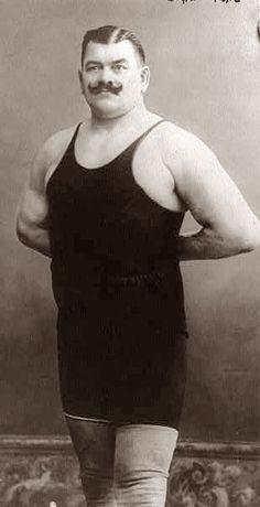 circus stereotype: strong man UNI-TARD :)