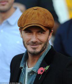 David Beckham cuts a dapper figure in suede headwear | Daily Mail Online